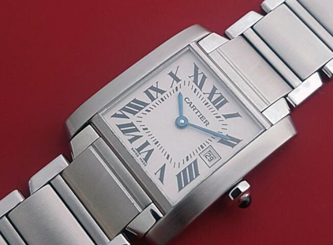 The blue hands and black hour markers are striking on the silver dial.