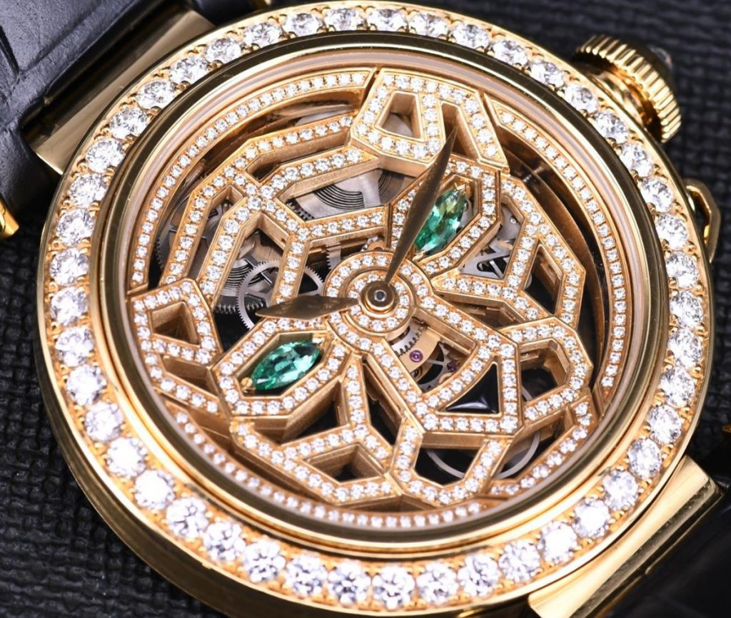 The 18k gold fake watch is decorated with diamonds.
