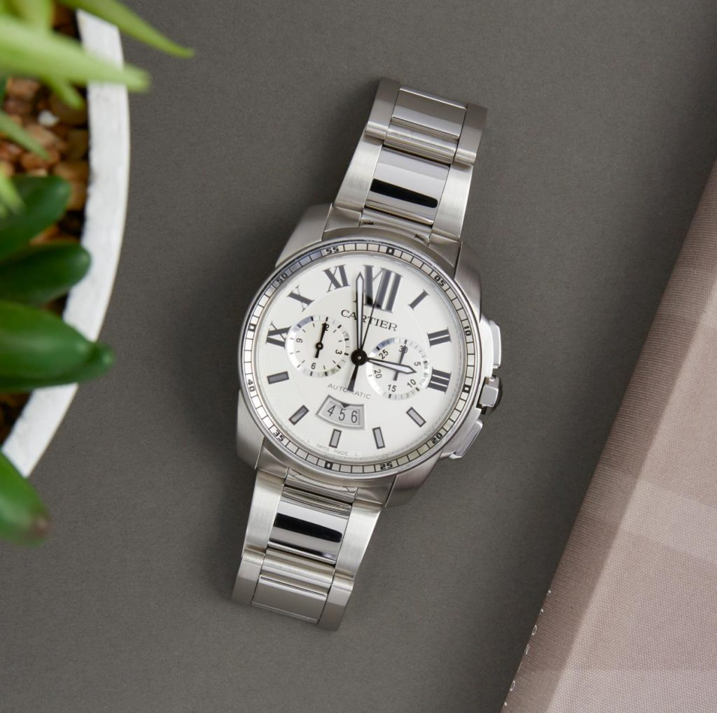 The 42mm replica watch has a white dial.